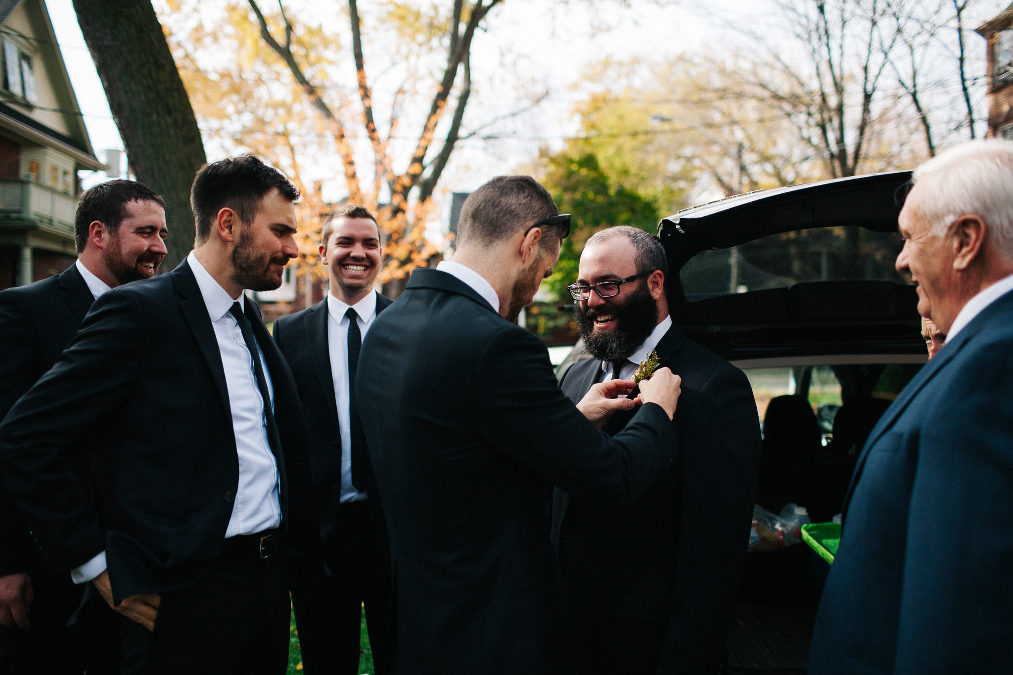 groomsmen getting dressed, groom photos, toronto wedding photographer, documentary wedding photographer, berkeley church wedding