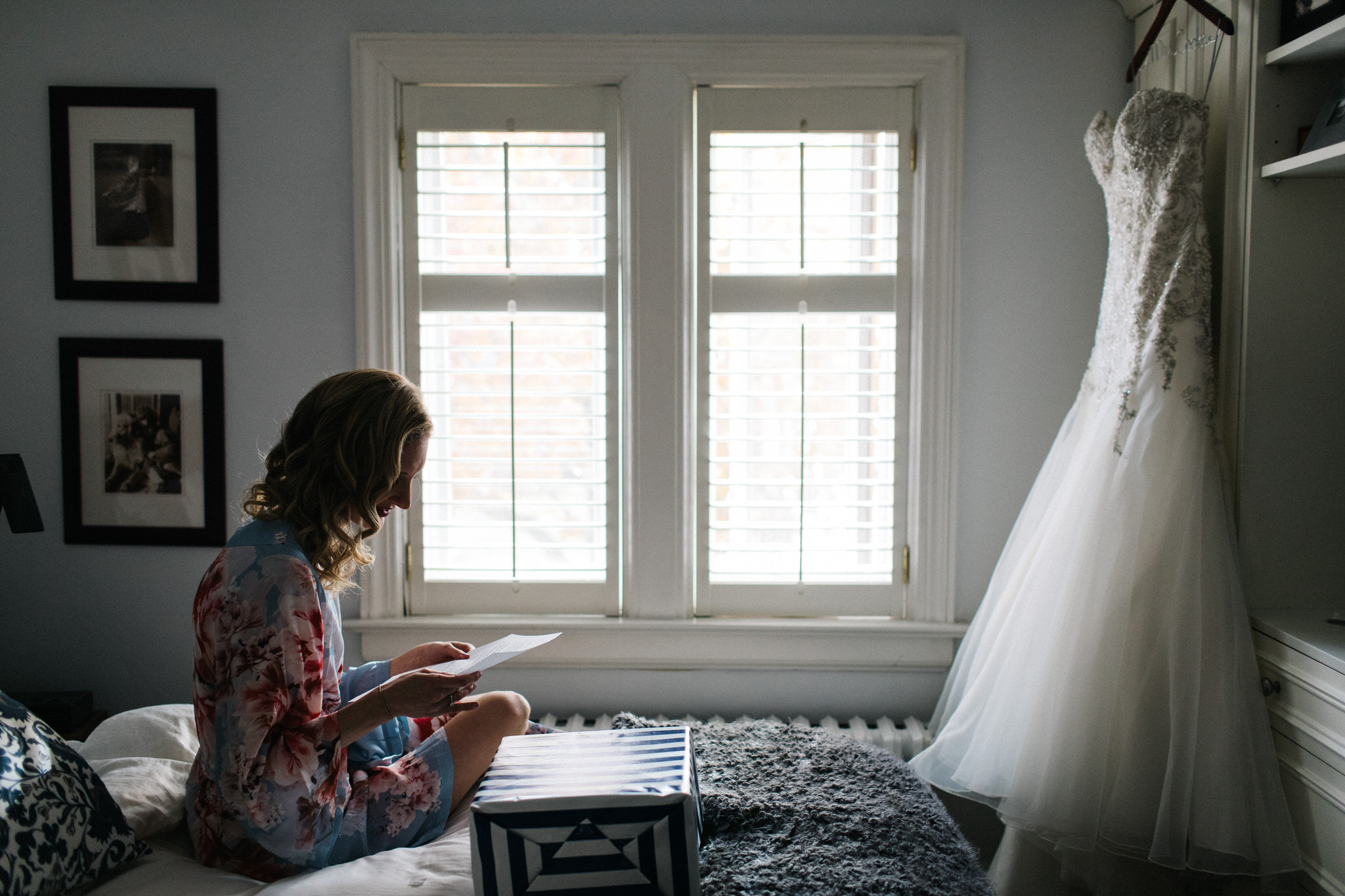 Bride opening gift, wedding day prep photos, toronto wedding photographer