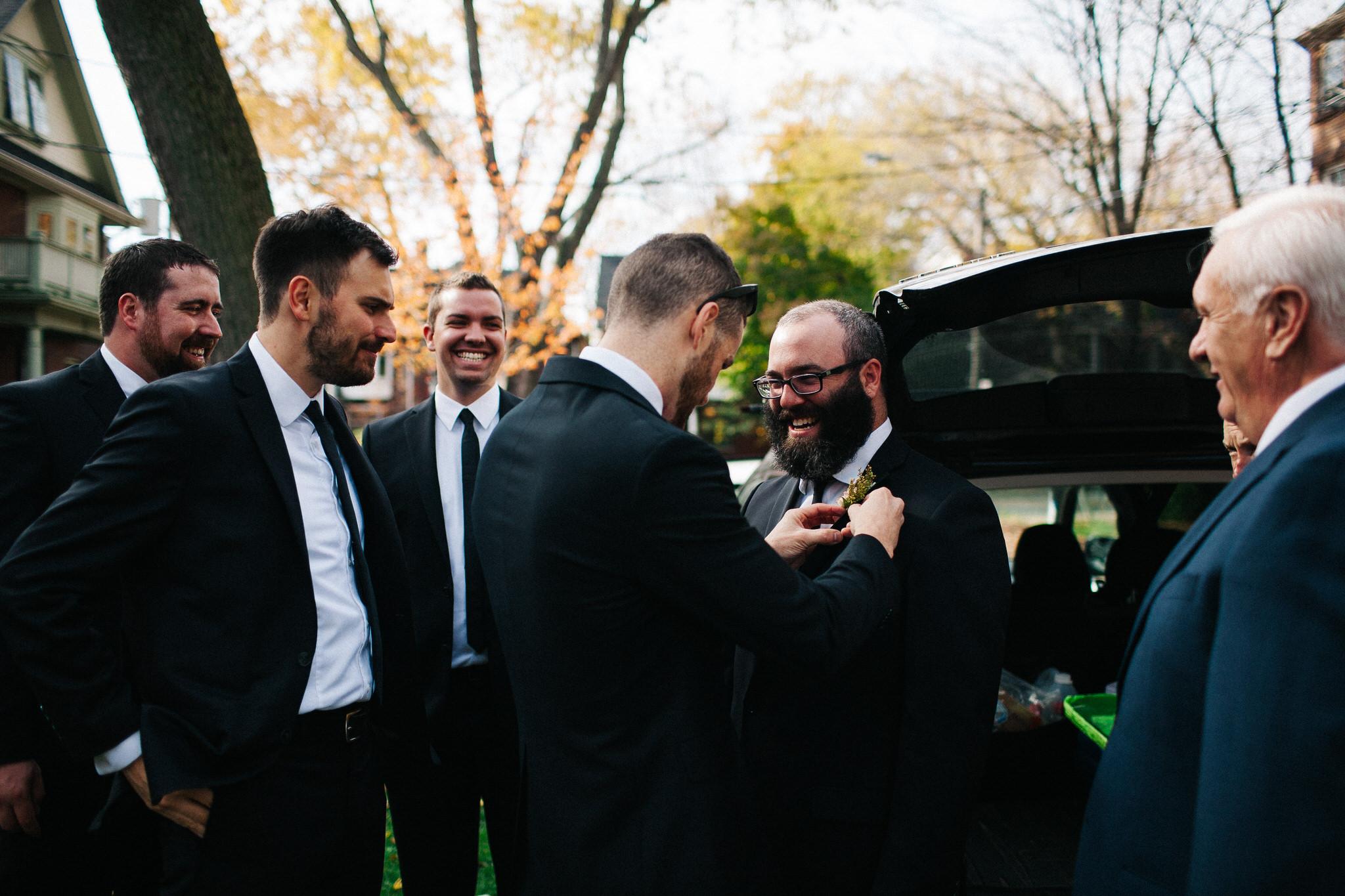 groomsmen getting dressed, groom photos, toronto wedding photographer, documentary wedding photographer, berkeley church wedding