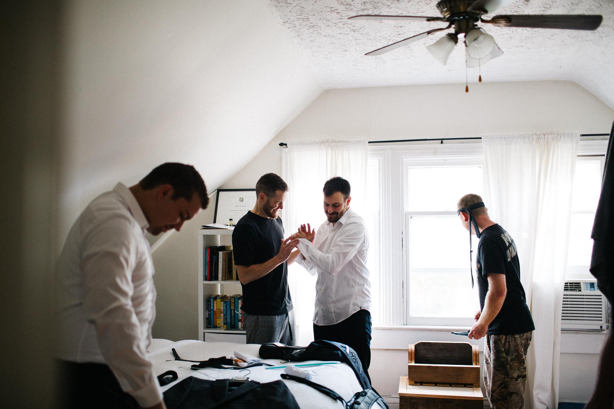 groom getting dressed, wedding day photos, documentary wedding photographer toronto, berkeley church toronto, groomsmen getting ready